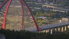 Beautiful view of Bugrinskiy bridge in Novosibirsk. slow motion. Beautiful view of downtown Novosibirsk in Russia stock footage