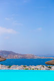 Beautiful view from the edge of infinity pool to the sea and the mountains in the greek town of Mykonos Stock Photo