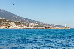 Beautiful view on embankment of Yalta. Sunny day. Stock Images