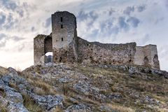 Beautiful view of Enisala old stronghold/citadel with cloudy sky and rocks Royalty Free Stock Images