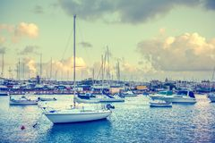 Beautiful view of european harbor with maltese yachts and boats. In Sliema, Malta, instagram style Stock Photos
