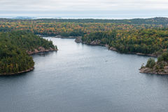 Beautiful view of a fall forest and lake from above Stock Images