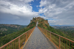 Beautiful view of famous Civita di Bagnoregio with Tiber river valley in golden evening light, Lazio, Italy Stock Photo