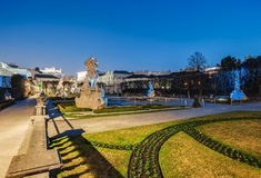 Beautiful view of famous  night time Mirabell Gardens with the old historic Fortress Hohensalzburg in the background in Salzburg Stock Photo