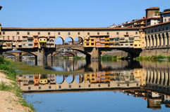 A Beautiful view of the famous Old Bridge Ponte Vecchio and Uffizi Gallery with blue sky in Florence as seen from Arno Royalty Free Stock Photography
