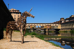 A Beautiful view of the famous Old Bridge Ponte Vecchio and Uffizi Gallery with blue sky in Florence as seen from Arno Royalty Free Stock Photo