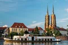 City tour ship and Wroclaw cathedral royalty free stock image
