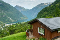 Beautiful view at fiord with wooden cabin at foreground Stock Photography
