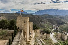 Beautiful view of the fortress and the Torre Blanca with the flag of Spain on a hill in the Alcazaba de Antequera stock image