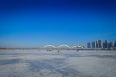 Beautiful view of frozen Songhua river during winter time in Harbin, China. Beautiful scenic view of frozen Songhua river during winter time in Harbin, China Stock Photography