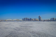 Beautiful view of frozen Songhua river during winter time in Harbin, China. Beautiful scenic view of frozen Songhua river during winter time in Harbin, China Royalty Free Stock Photo