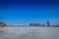 Beautiful view of frozen Songhua river during winter time in Harbin, China. Beautiful scenic view of frozen Songhua river during winter time in Harbin, China Royalty Free Stock Photos