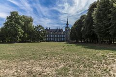Beautiful view of the garden with dry grass with its green leafy trees. With the Eijsden castle in the background, wonderful sunny day in South Limburg in the stock images