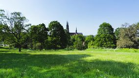 Beautiful view of geen city landscape with top of famous cathedral towers on blue sky background. Europe.Sweden. stock footage