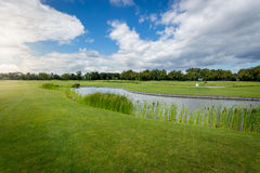 Beautiful view of golf course with water hindrance. At sunny day stock photo
