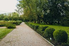 Beautiful view of green city park with flower beds stock photos