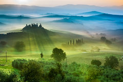 Beautiful view of green fields and meadows at sunset in Tuscany Royalty Free Stock Photo