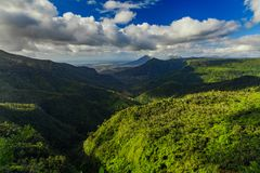 Beautiful view of the green mountains of the tropical island of Mauritius Royalty Free Stock Photo