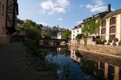 The Alzette river winding through Grund, Luxembourg Stock Image