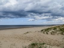 Beautiful view of the Gulf of Riga in early spring, in anticipation of thunderstorms.  stock photos