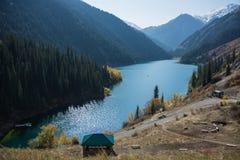 Beautiful view of high mountain lake Kolsai in Kazakhstan, centr. Beautiful view of high blue mountain lake Royalty Free Stock Images