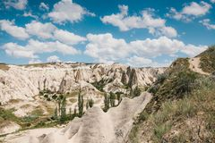 Beautiful view of the hills of Cappadocia. One of the sights of Turkey. Tourism, travel, beautiful landscapes, nature. Beautiful view of the hills of Cappadocia Royalty Free Stock Photo