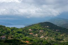 Beautiful view of the hills and the sea lagoon under a cloudy sky on Elba Island in Tuscany royalty free stock images