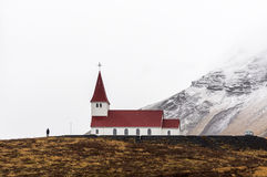 Beautiful view of hilltop Church in Vik during winter season, Iceland.  Stock Photo
