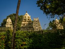 Beautiful view of a hindu temple with some sculptures around the building in a beautiful blue sky. In India Royalty Free Stock Photos