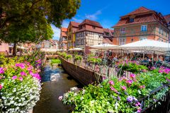 Beautiful view of the historic town of Colmar, France. Beautiful view of the historic town of Colmar, also known as Little Venice, with tourists taking a boat Royalty Free Stock Image