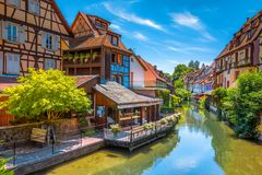 Beautiful view of the historic town of Colmar, France. Beautiful view of the historic town of Colmar, also known as Little Venice, with tourists taking a boat Stock Images