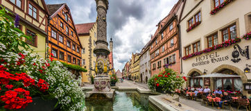 Beautiful view of the historic town of Rothenburg ob der Tauber with fountain, Franconia, Bavaria, Germany Stock Photography