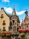 Beautiful view of the historic town square of Eguisheim, a popular tourist destination along the famous Alsace Wine Route, on a su. Nny day with blue sky, Alsace Royalty Free Stock Image