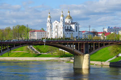 Beautiful view of Holy Dormition Cathedral and Kirovsky Bridge across Western Dvina River, Vitebsk, Belarus Stock Images