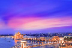 Beautiful view of the Hungarian Parliament and the Szechenyi chain bridge across the Danube in the panorama of Budapest at night Royalty Free Stock Photos