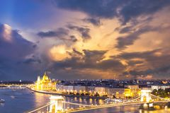 Beautiful view of the Hungarian Parliament and the Szechenyi chain bridge across the Danube in the panorama of Budapest at night Stock Photos