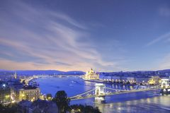 Beautiful view of the Hungarian Parliament and the Szechenyi chain bridge across the Danube in the panorama of Budapest at night Stock Image