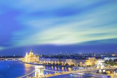 Beautiful view of the Hungarian Parliament and the Szechenyi chain bridge across the Danube in the panorama of Budapest at night Royalty Free Stock Image