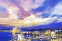 Beautiful view of the Hungarian Parliament and the Szechenyi chain bridge across the Danube in the panorama of Budapest at night Royalty Free Stock Images