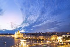 Beautiful view of the Hungarian Parliament and the Szechenyi chain bridge across the Danube in the panorama of Budapest at night Stock Photography