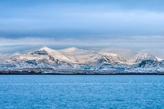 Beautiful view of Iceland winter season. With snow-capped mountain in the background and sea in the foreground Royalty Free Stock Photo