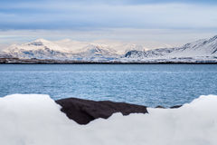 Beautiful view of Iceland winter season. With snow-capped mountain in the background and snow in the foreground Royalty Free Stock Photography