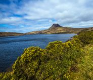 Beautiful view of the iconic mountain Stac Pollaidh on the shore of Loch Lurgainn in the Highlands of Scotland royalty free stock image