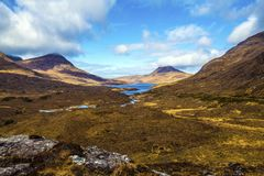 Beautiful view of the iconic mountain Stac Pollaidh on the shore of Loch Lurgainn in the Highlands of Scotland stock image