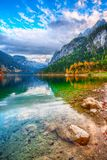 Beautiful view of idyllic colorful autumn scenery in Gosausee la. Beautiful view of idyllic colorful autumn scenery with Dachstein mountain summit by Gosausee stock photos