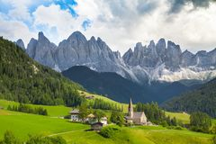Val di Funes, South Tyrol, Italy. Beautiful view of idyllic mountain scenery in the Dolomites with famous Santa Maddelana mountain village on a sunny day with royalty free stock photography