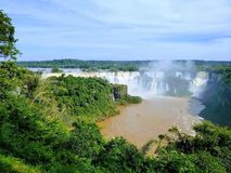 Beautiful view of iguazu Falls, Paraná, Brazil. Beautiful view of iguazu falls, á, water, waterfall, forest, power, river, green, sunny, sky royalty free stock photography