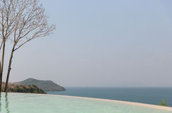 Beautiful view from infinity edge pool to sea Royalty Free Stock Photos