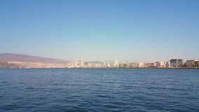 Beautiful view of Izmir city from a ferry in Aegean sea. Cityscape of Izmir from a boat trip on a sunny day stock video footage
