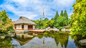 Beautiful view of Japanese Garden in Planten um Blomen park with famous Heinrich-Hertz-Turm tower, Hamburg, Germany Stock Image